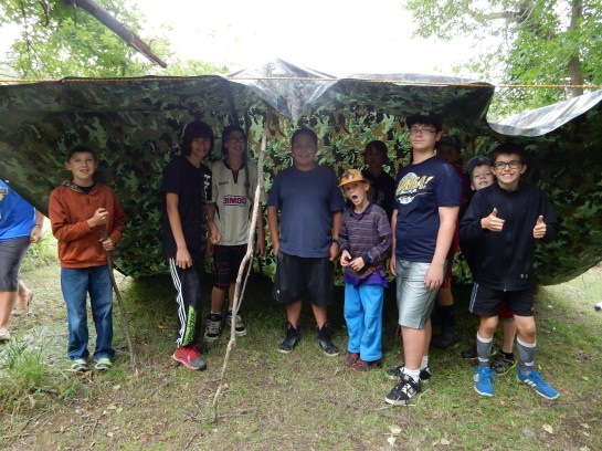 During the camp skills challenge we learned to build a shelter. The dub made us go under it and threw a bucket of water on to it to make sure it didn't leak! Thank goodness none of us got wet!